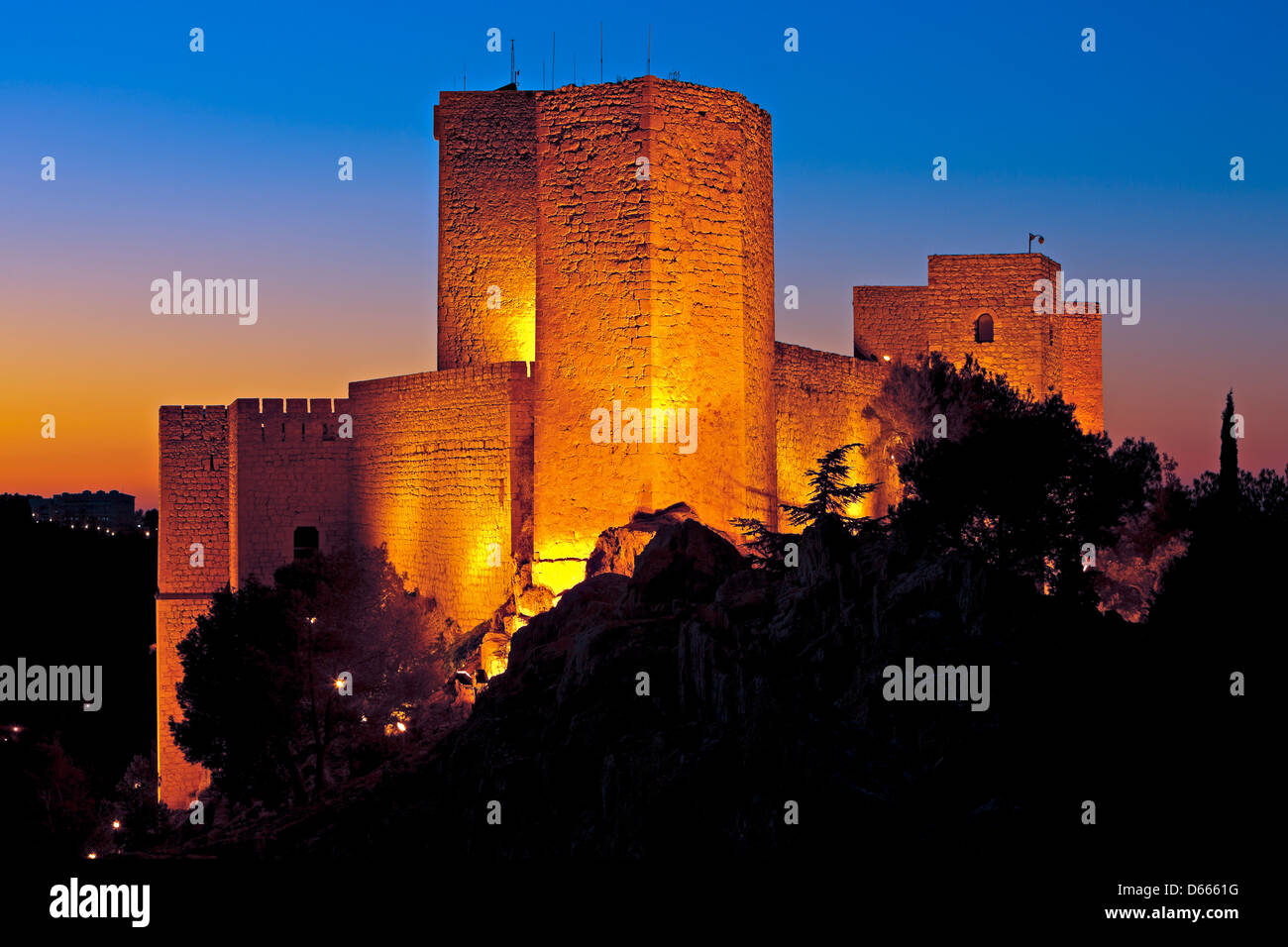 Walls and towers of the Castillo de Santa Catalina (Castle) at dusk in the City of Jaen, Province of Jaen, Andalusia - Stock Image