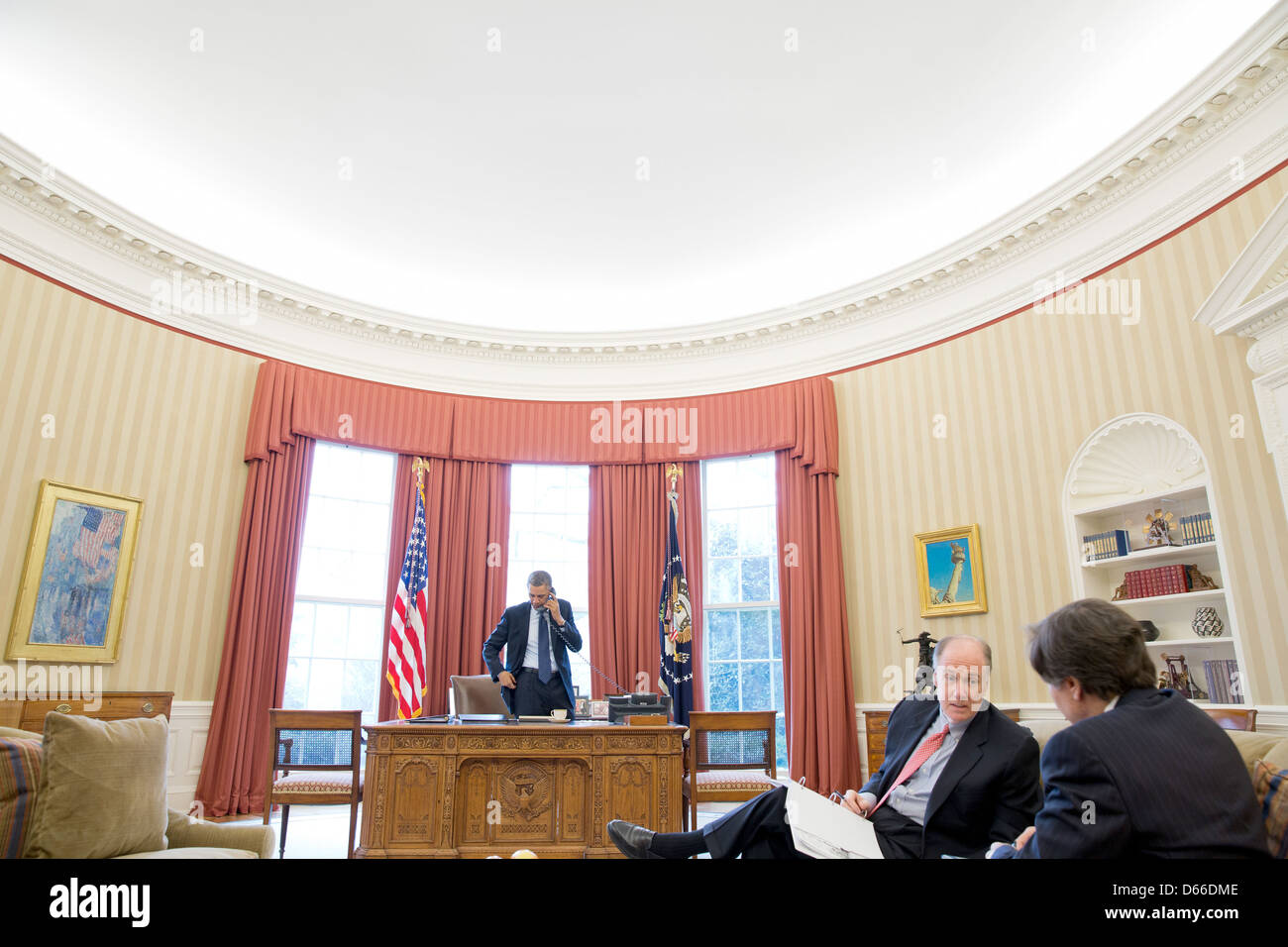 US President Barack Obama talks on the phone with President Vladimir Putin of Russia from the Oval Office March - Stock Image