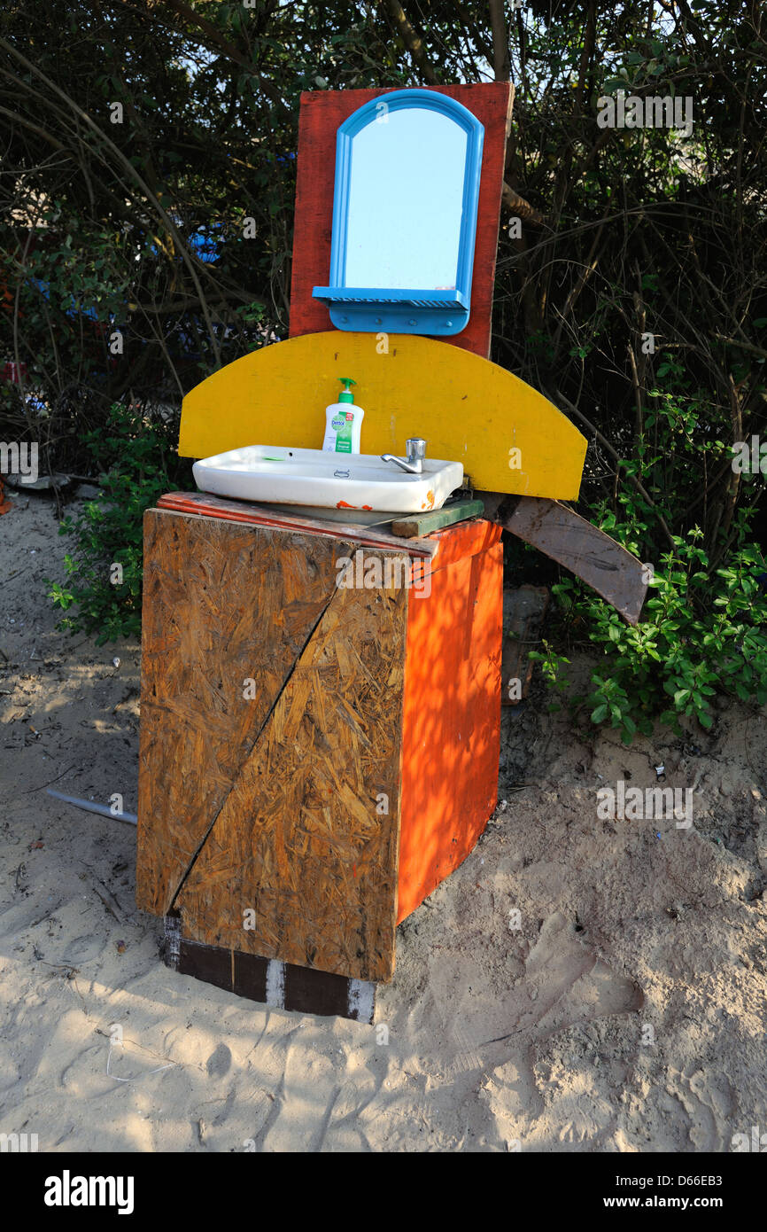 Wash basin on the beach in Goa,India - Stock Image