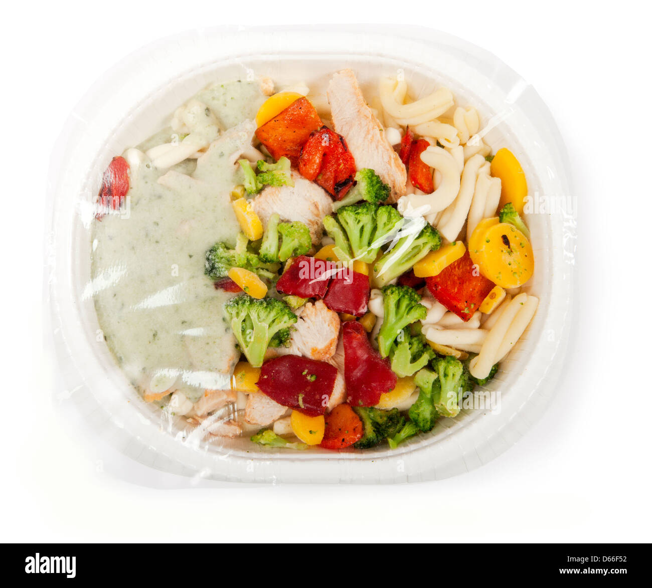 paper plate with prepackaged fast food with plastic foil on top. - Stock Image