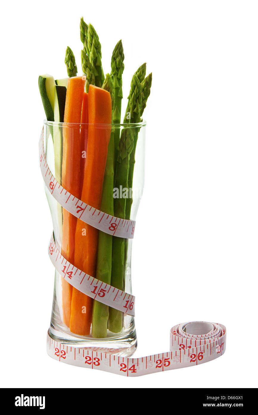 Low calorie vegetable in an hour glass shaped glass with measuring tape - Stock Image