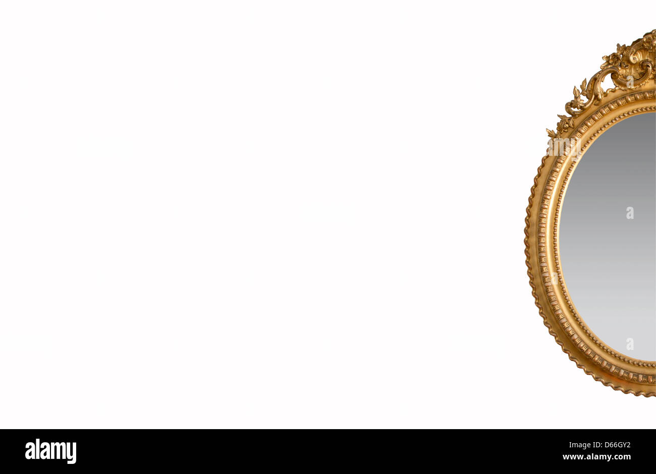 An ornate golden mirror on a white background. - Stock Image