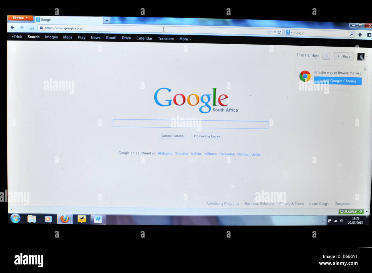 Image of a computer screen showing the Google South Africa homepage. - Stock Image
