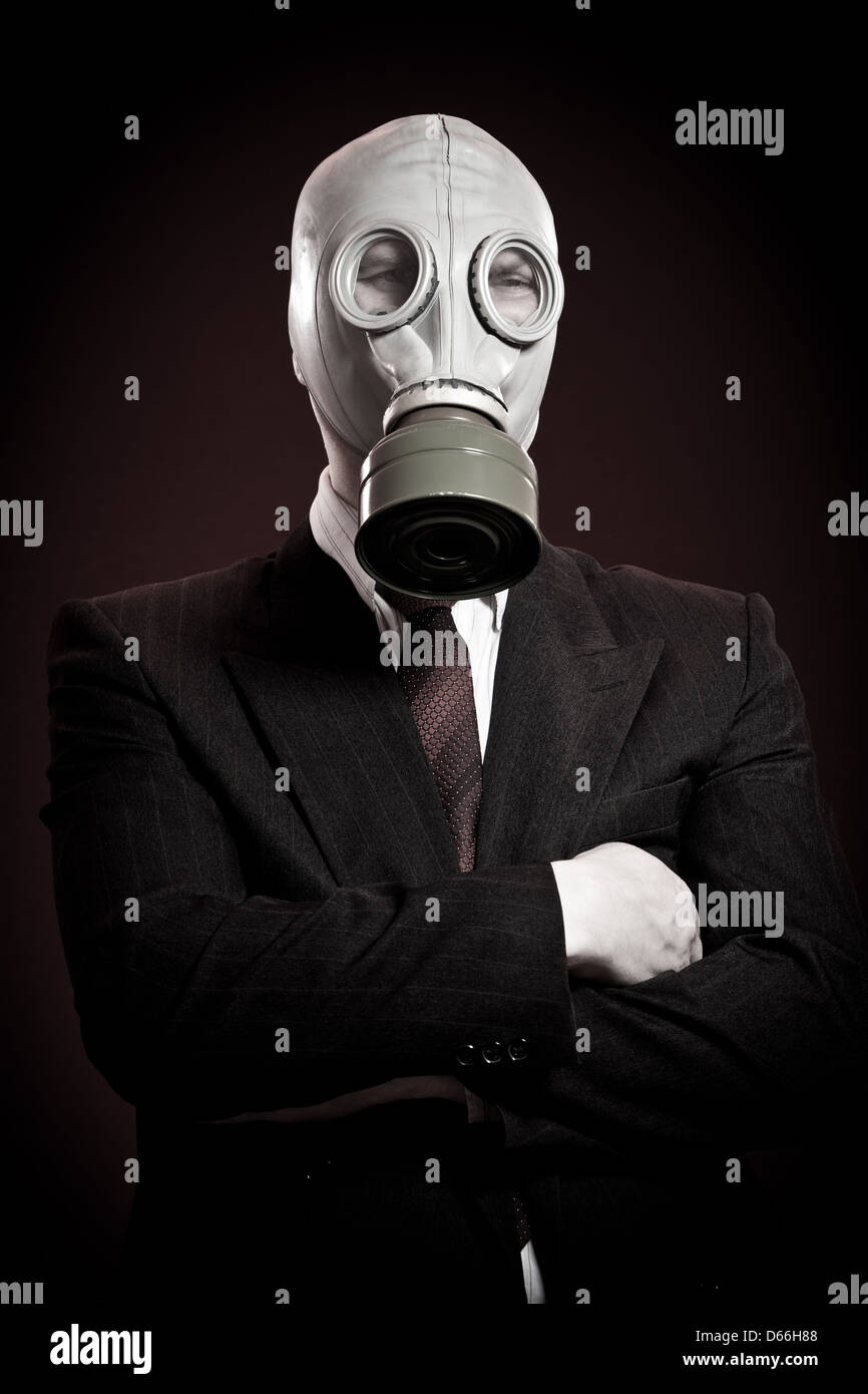 person in a gas mask on a dark background - Stock Image