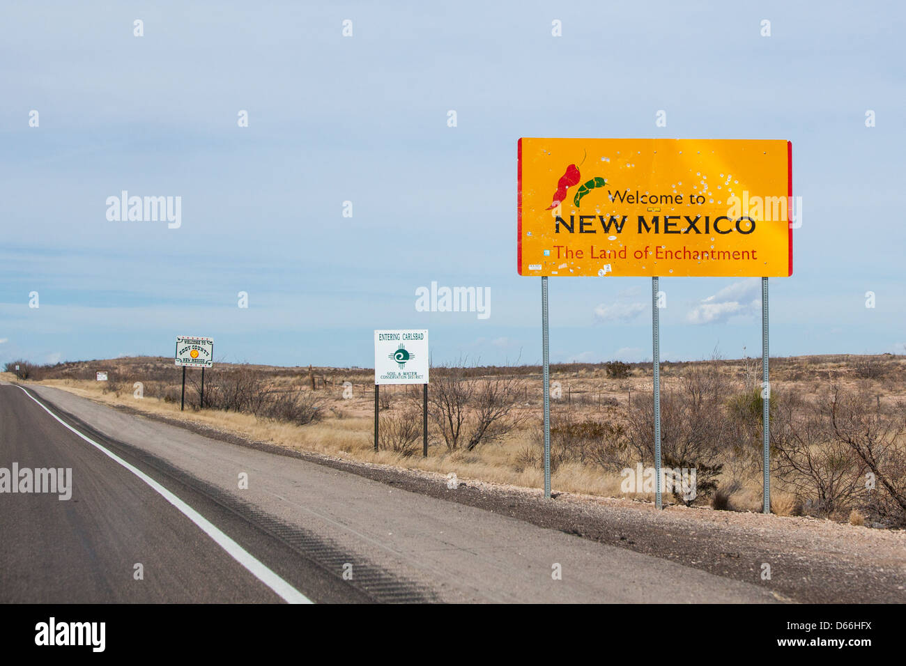 A bullet laden sign on the Pecos Hwy marking the border of New Mexico from Texas Stock Photo