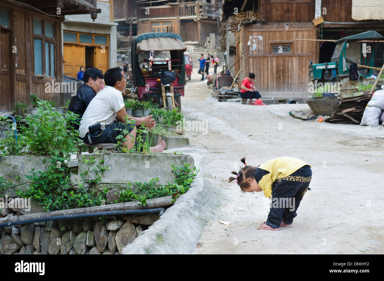 Funny Street Scene Zhaoxing village and river in the Guizhou province of China - Stock Image