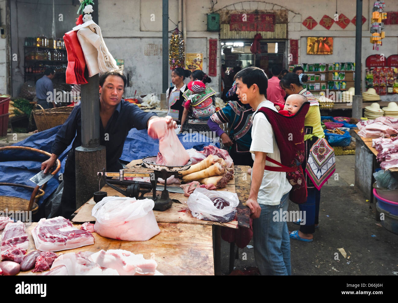Meat Department of the Yuanyang Market in Yunnan province of China Stock Photo