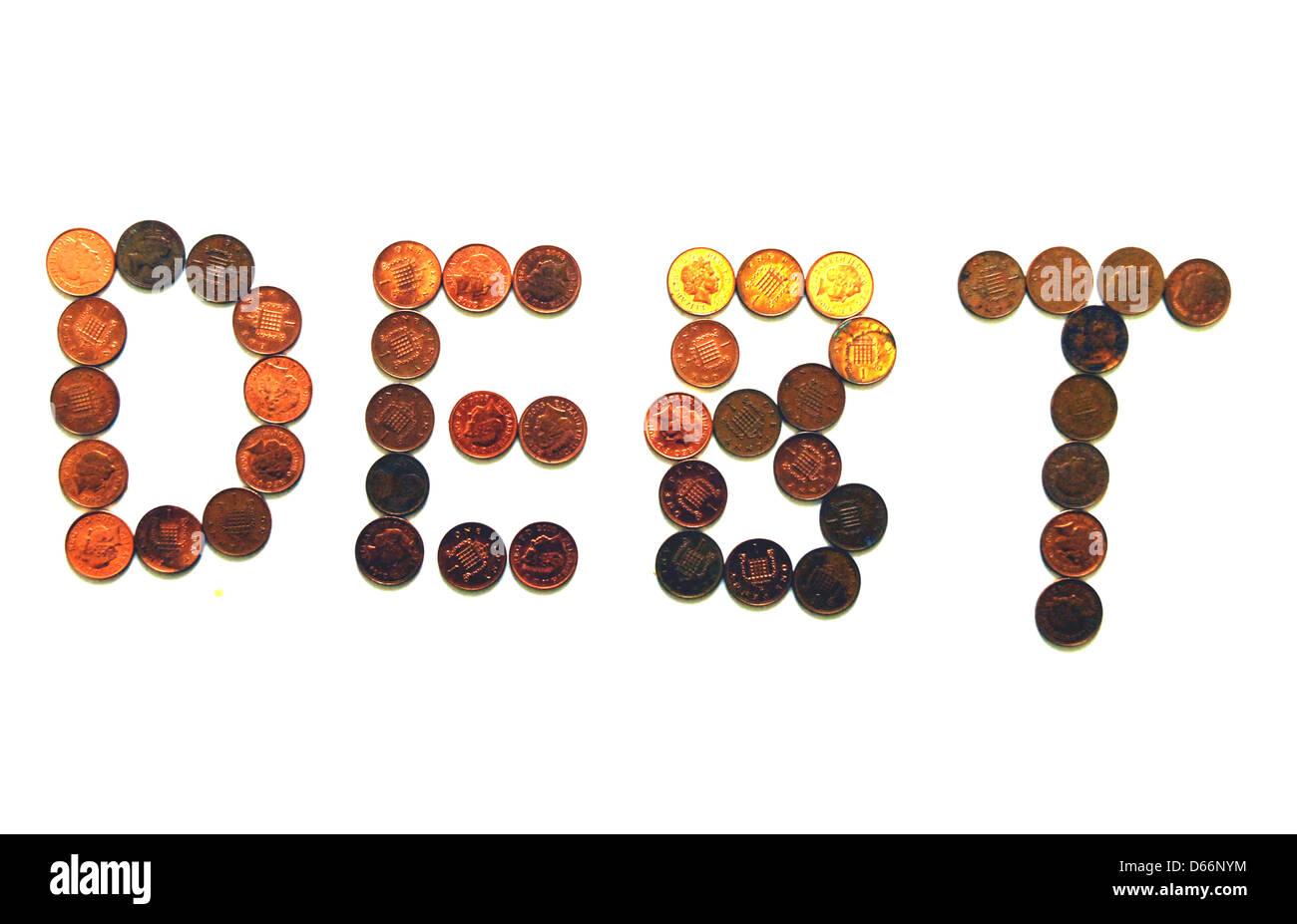 Debt spelt in pennies. - Stock Image