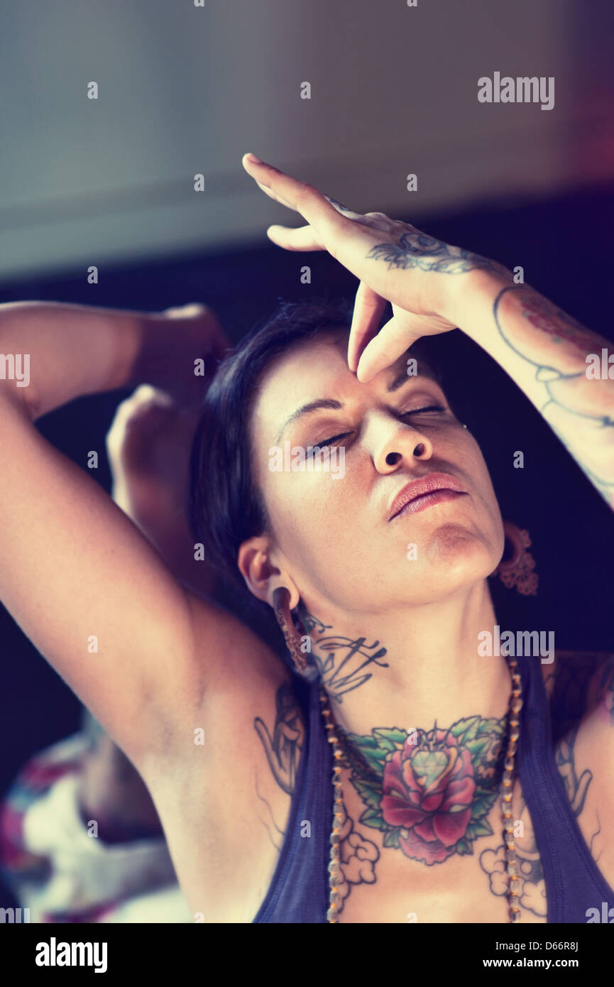 Woman touching her third eye with hand mudra. - Stock Image