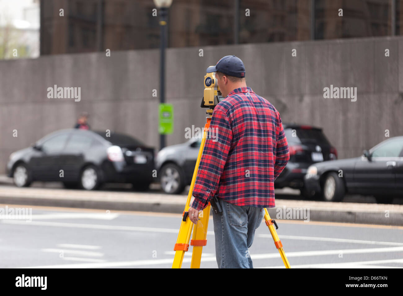 Land surveyor looking through a digital theodolite - USA - Stock Image