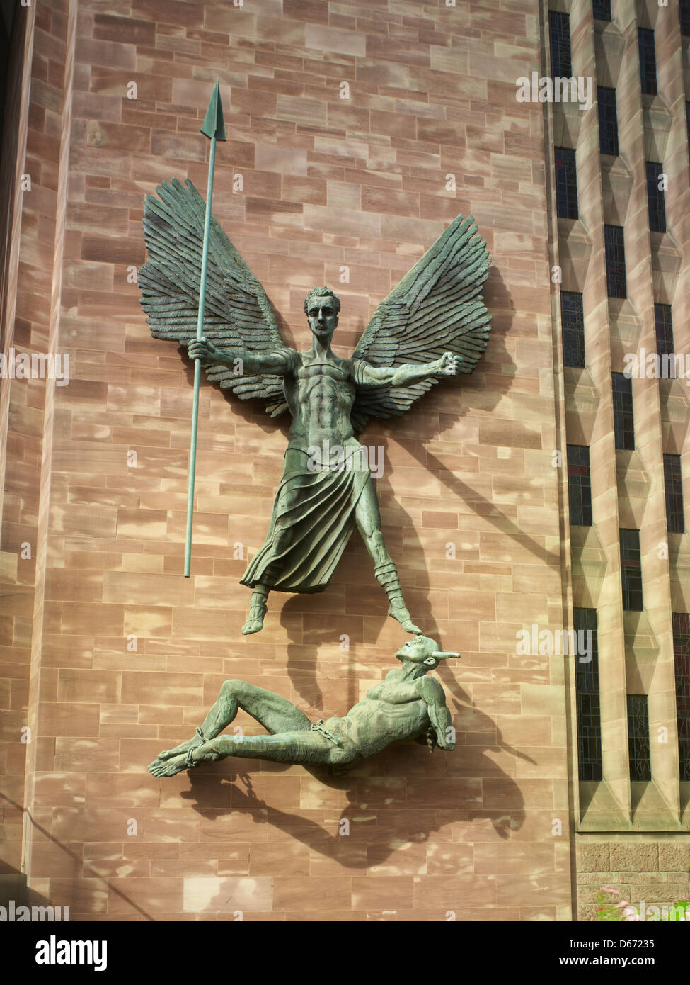 Coventry Cathedral of St Michael: giant bronze statue of St. Michael subduing the Devil by sculptor Jacob Epstein - Stock Image