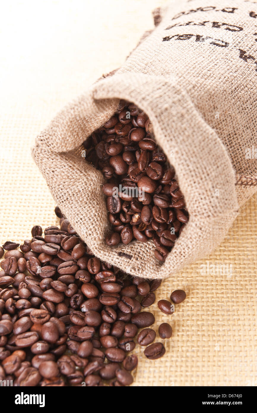 Coffee beans in the gray bag - Stock Image