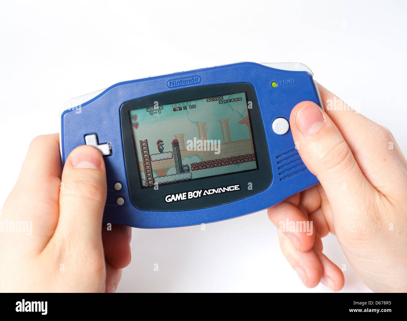 Super Mario Advance being played on the Nintendo Game Boy Advance - Stock Image