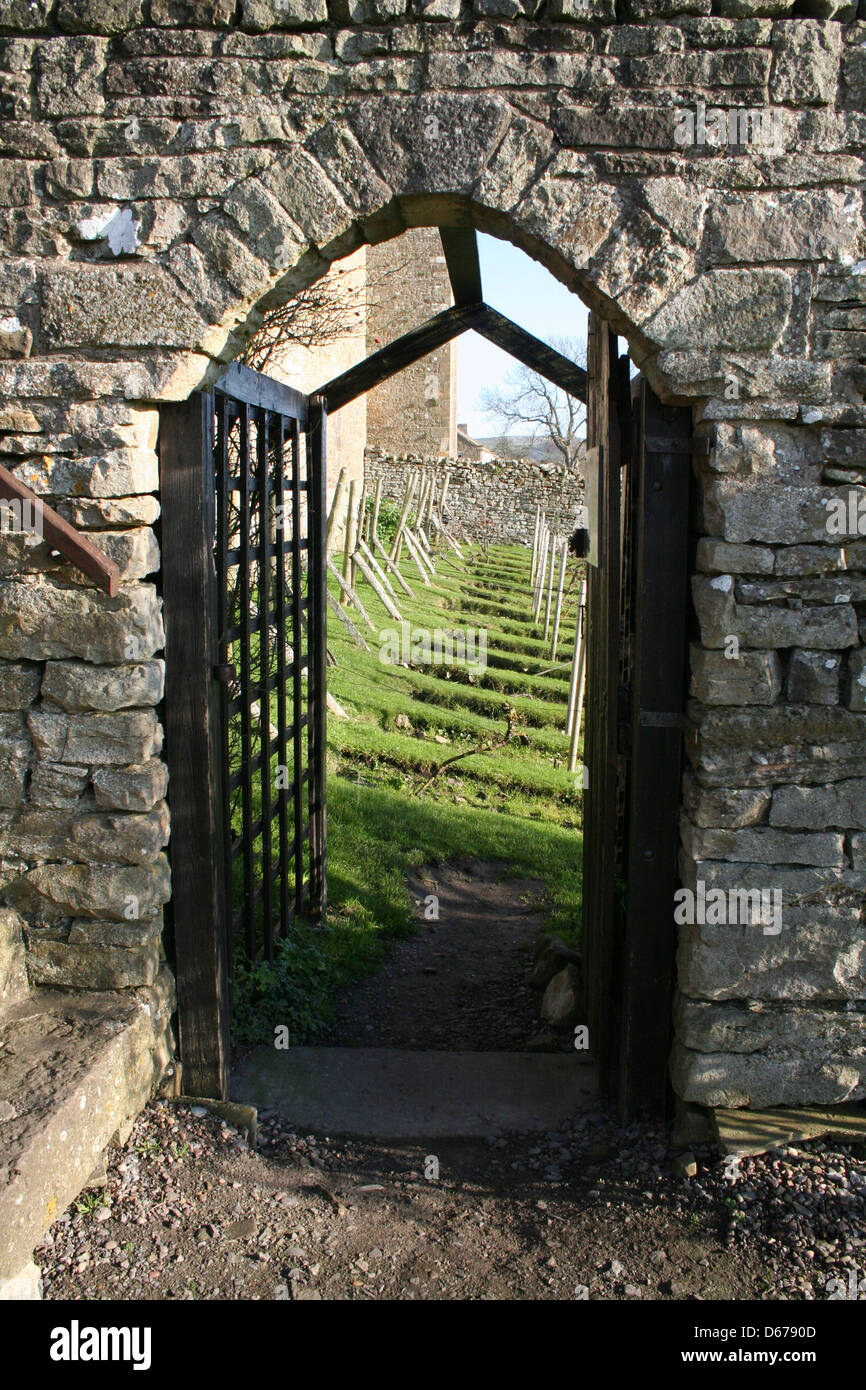 Stone gateway leading into the gardens of Bolton castle in Wensleydale North Yorkshire. - Stock Image