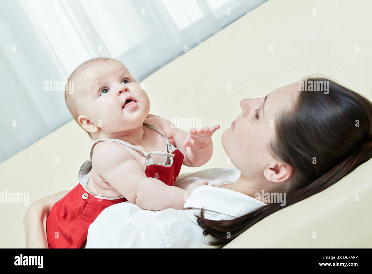 Mother game with her child at home Stock Photo