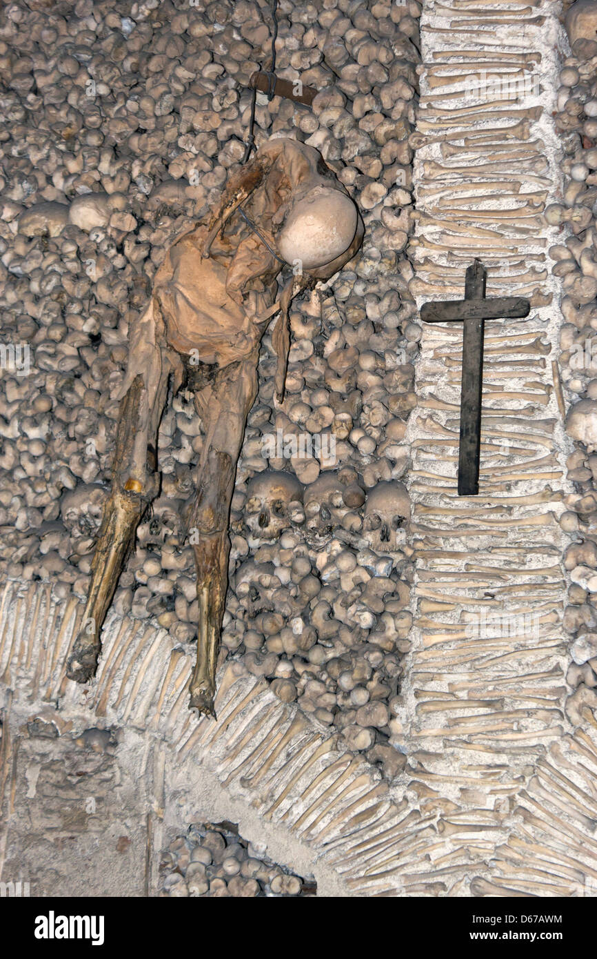 Évora, Portugal. Skeleton hanging from the wall in The Capela dos Ossos or Chapel of Bones. - Stock Image