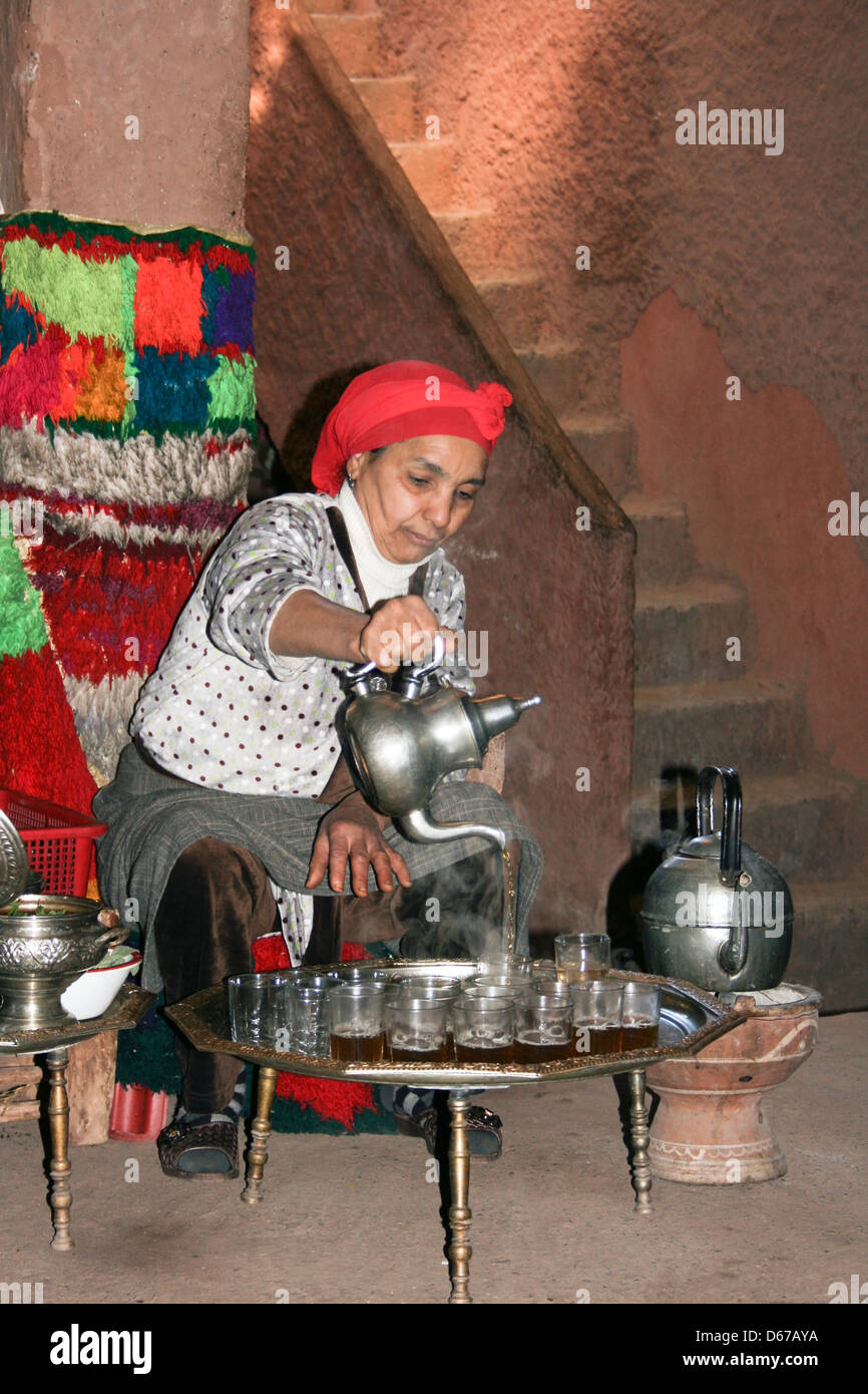Ourika Valley, Morocco. Local woman serving Moroccan mint tea. - Stock Image