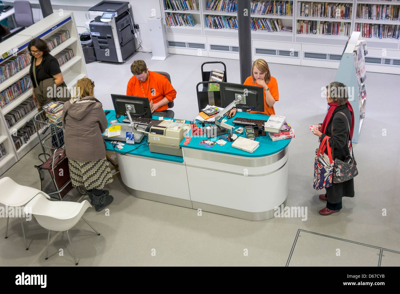 Library Book Checkout Check out Enquiry Desk - Stock Image