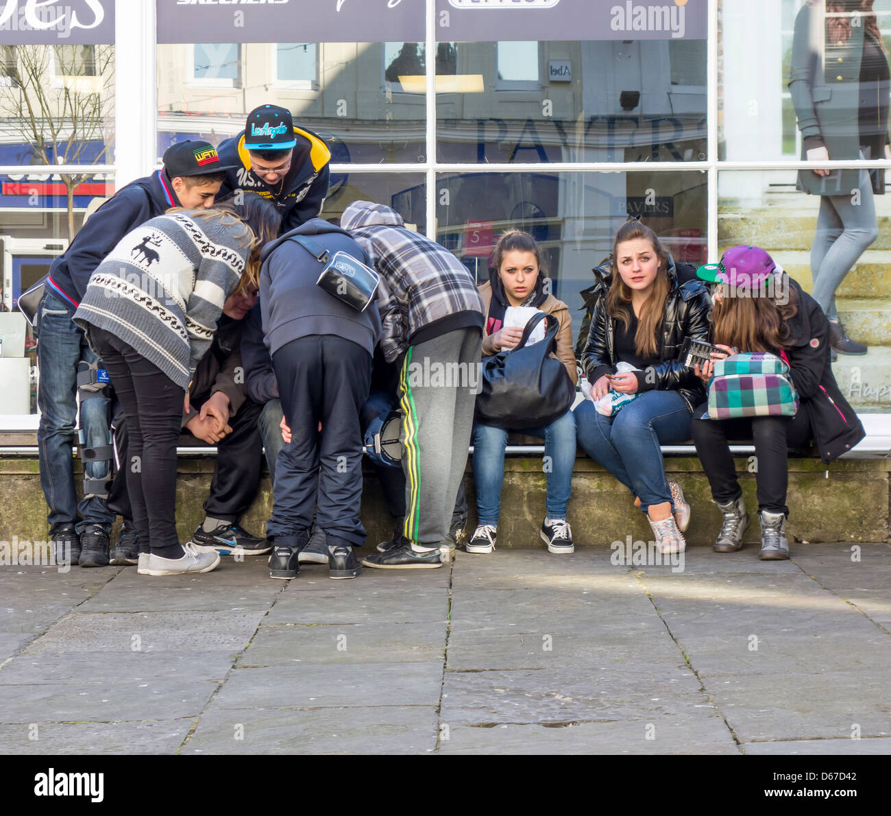 Group of Teenagers Adolescents Gathering Loitering - Stock Image