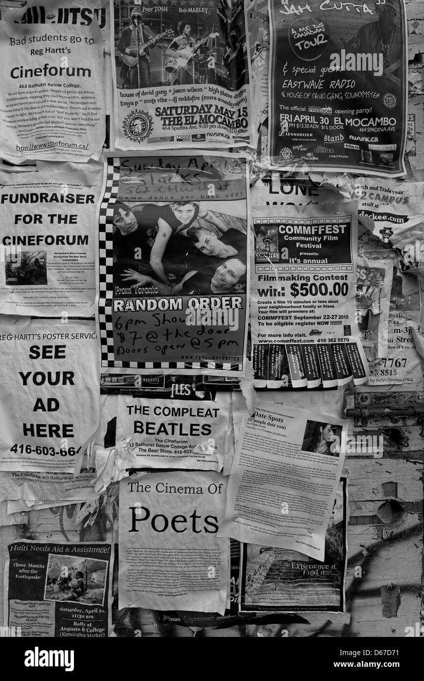 Black and white of fliers (flyers) or handbills posted on a wall - Stock Image