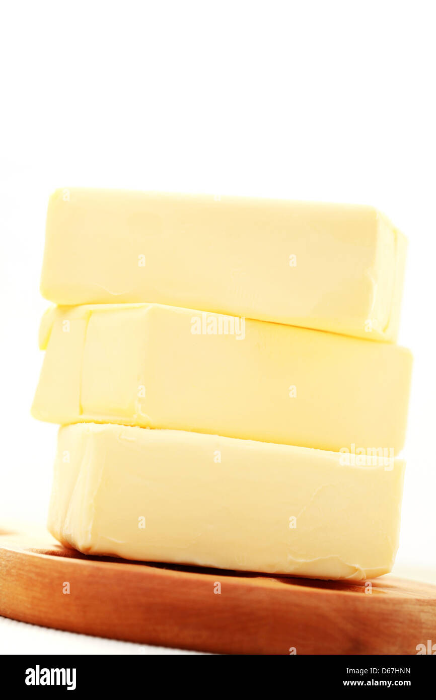 stacked,butter,butter pieces - Stock Image