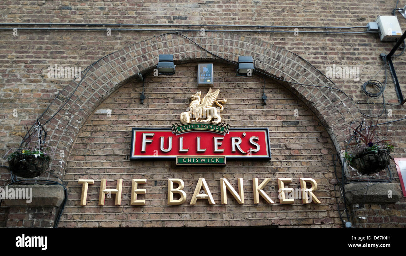 Fullers pub located on the River Thames  sign The Banker in Southwark London England UK  KATHY DEWITT - Stock Image