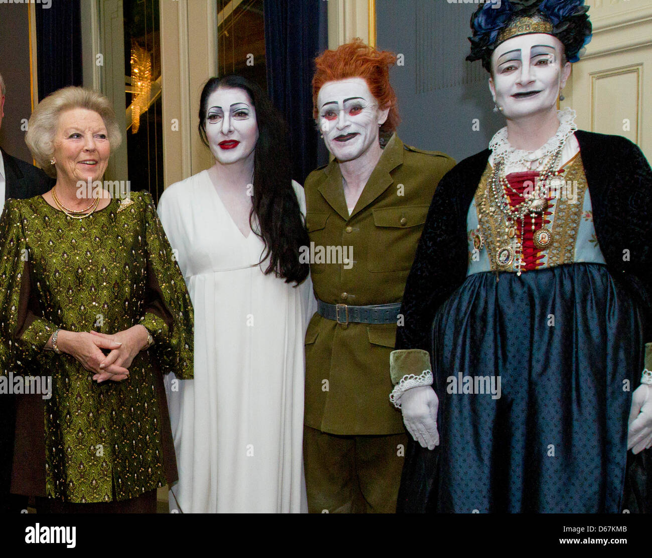 Queen Beatrix of The Netherlands (L-R) poses with Serbian-born artist Marina Abramovic and US actor Willem Dafoe Stock Photo