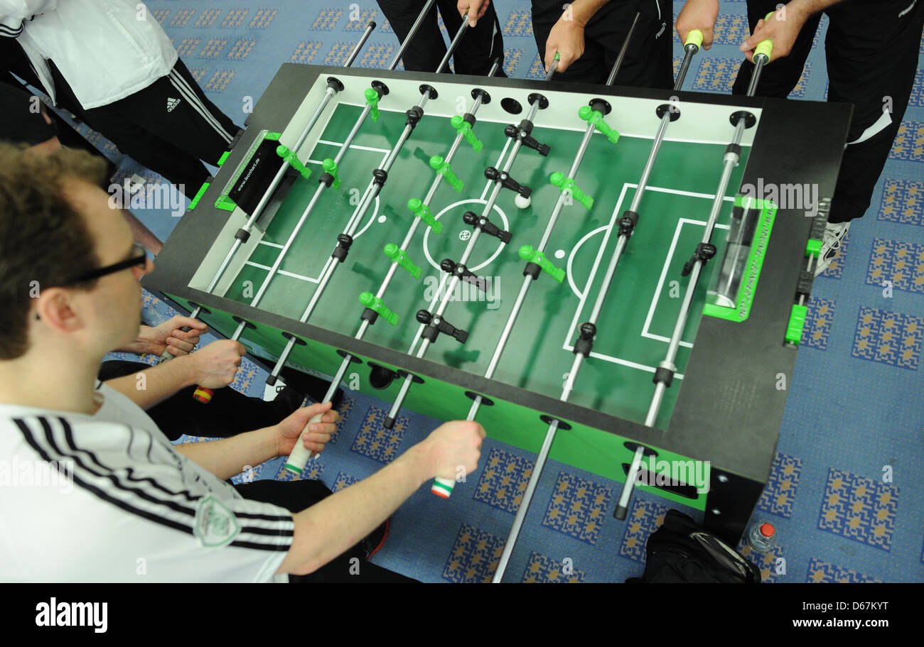 Players of KGB Hannover (L) and KMTV Hasselt (Belgium) play a match at the table soccer European Champions Cup in - Stock Image