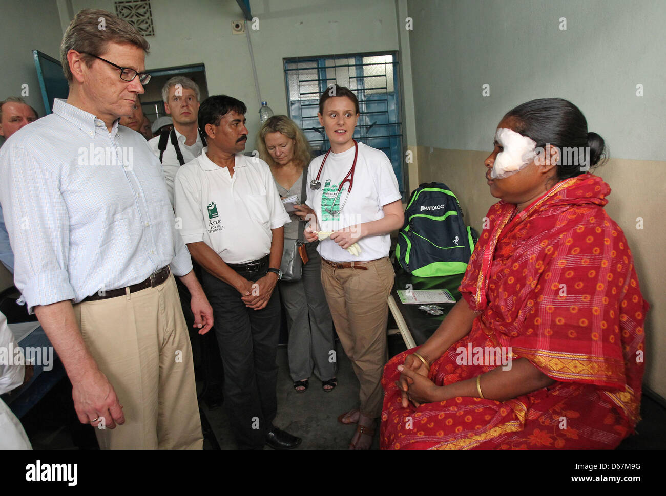 German Foreign Minister Guido Westerwelle (L-R), hospital director Aminul Hoq and doctor Anja Gebauer stand in a Stock Photo