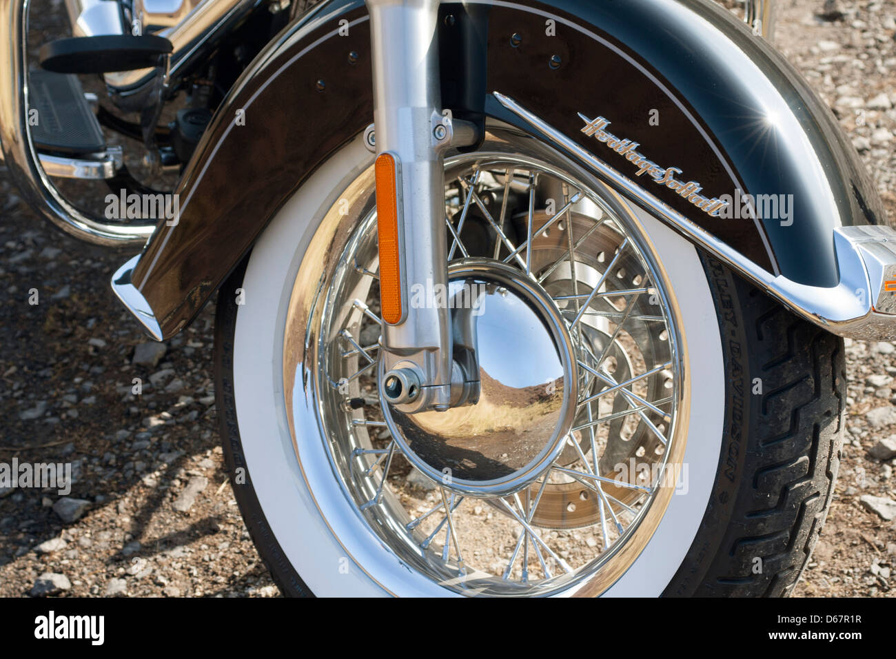 Harley Davidson FLSTC Softail Heritage Classic 2013 front wheel close up abstract image - Stock Image