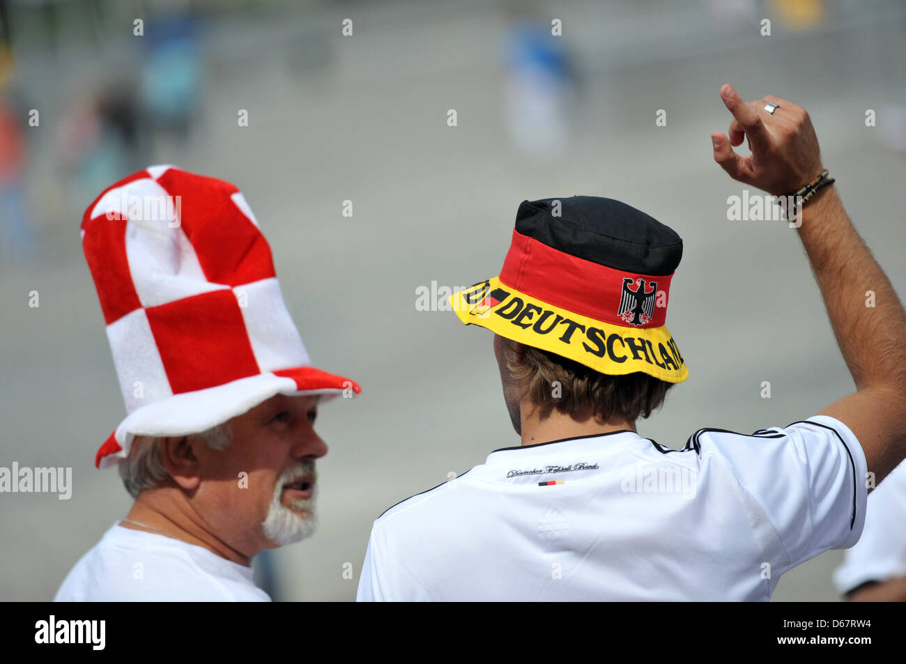 A German fan and a supporter of the Polish team walk through