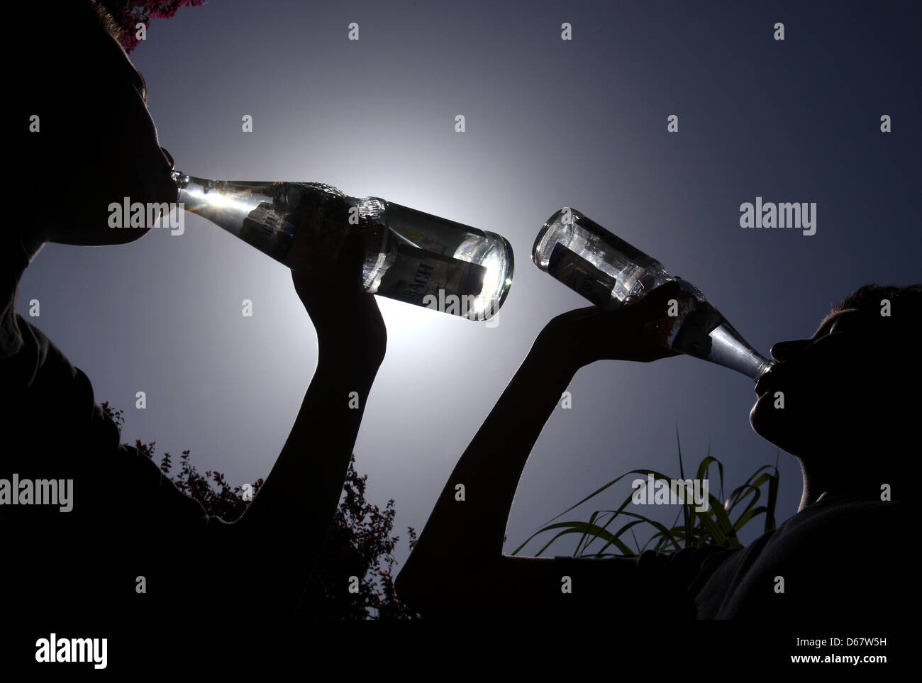 An archive photo dated 23 August 2011 shows young people drinking mineral water from bottles in bright sunlight - Stock Image