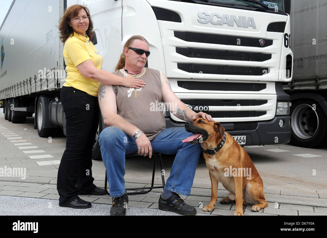 Truck driver Thomas Mindermann from Bremerhaven receives a Reiki treatment by Renate Holzfoerster at the rest house - Stock Image