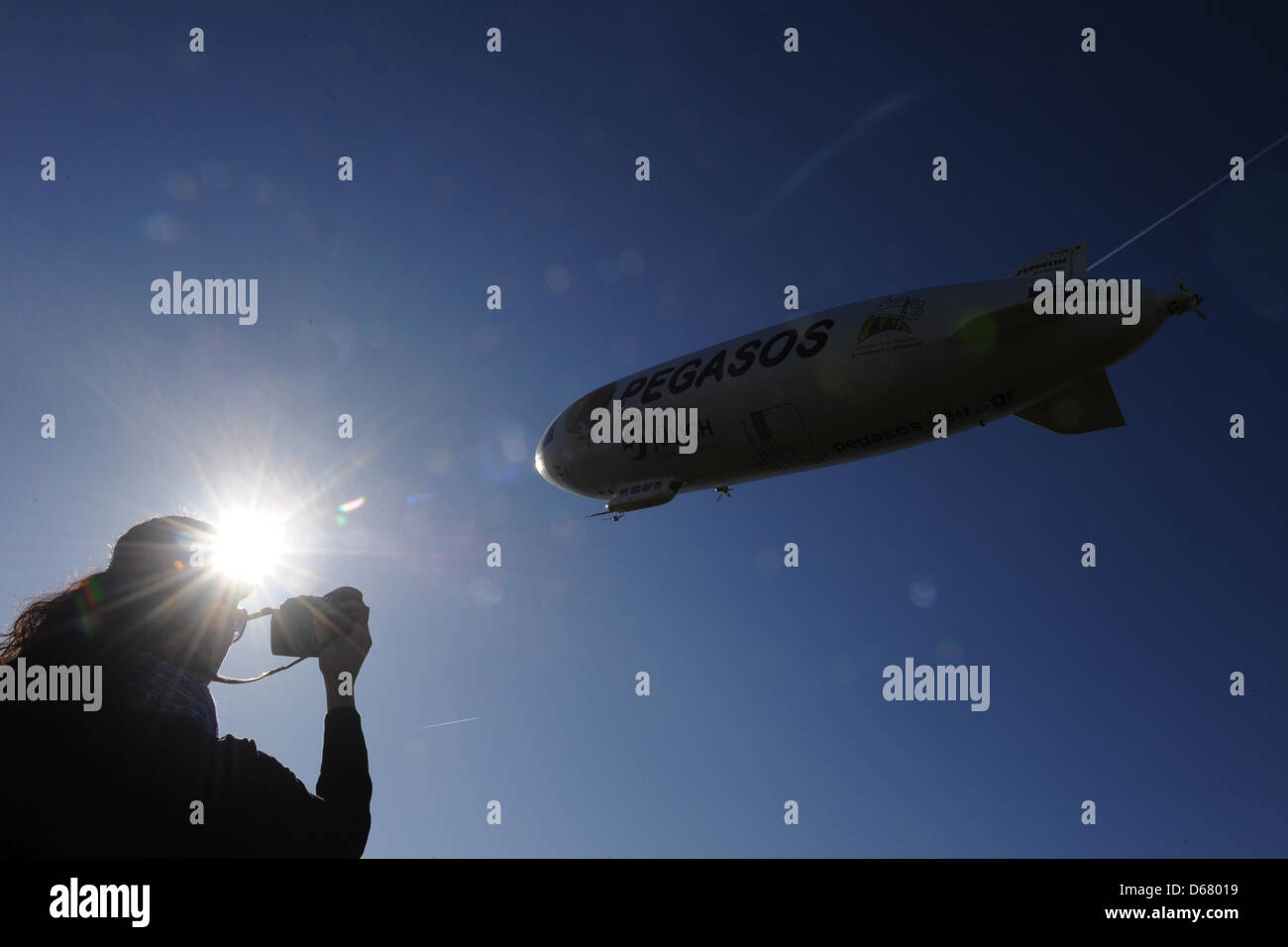 An employee of a zeppelin building company observes the airship NT (New Technology) as it takes off to an eleven - Stock Image