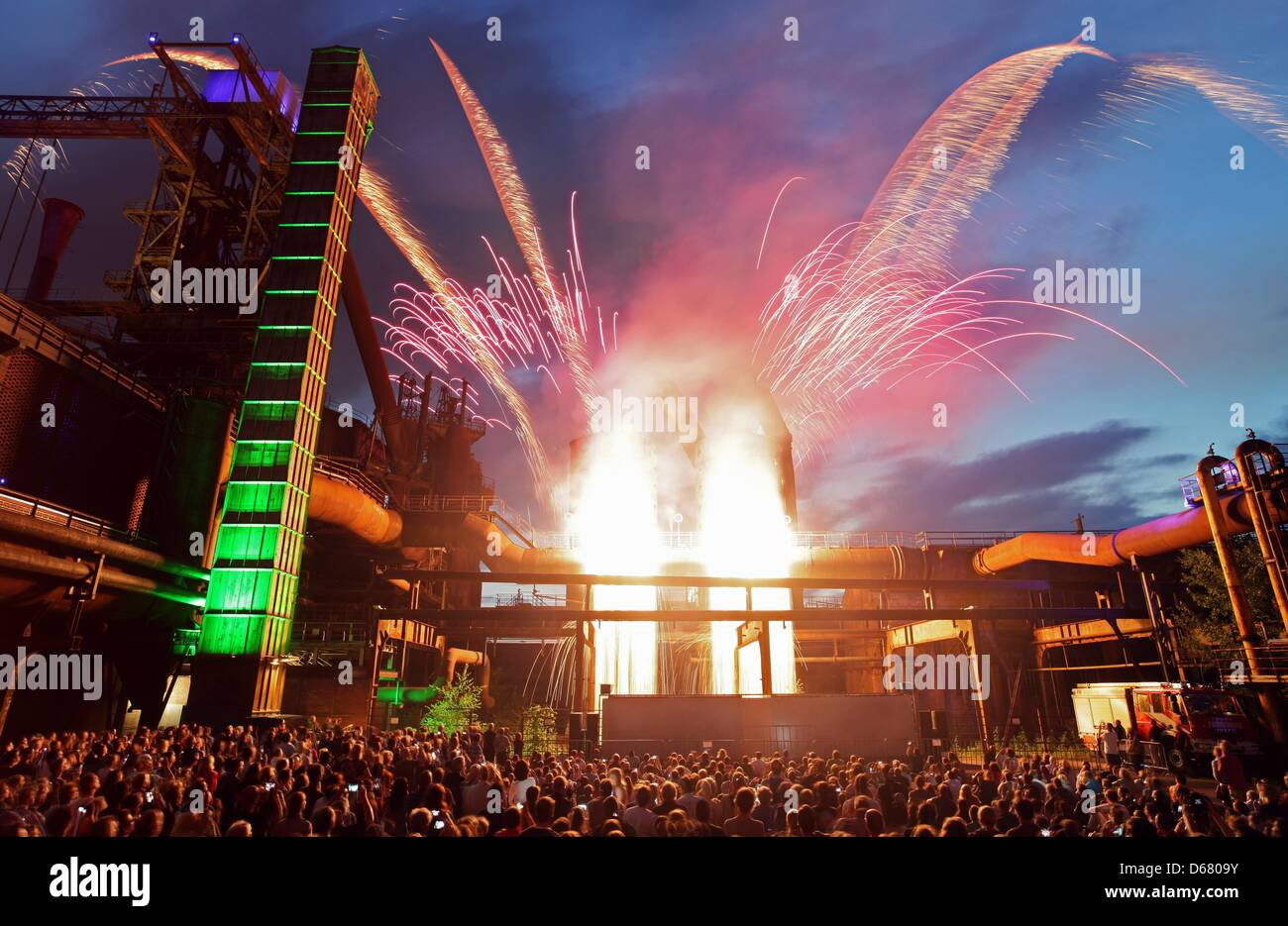 Visitors of the Night of Industrial Culture, also known as 'ExtraSchicht', watch the fireworks in Duisburg, - Stock Image