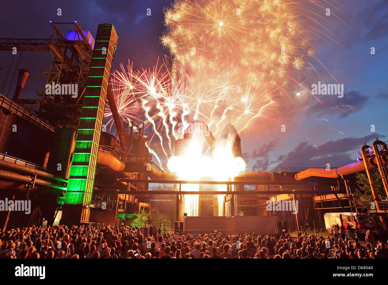 Visitors of the Night of Industrial Culture, also known as 'ExtraSchicht', view the fireworks in Duisburg, - Stock Image