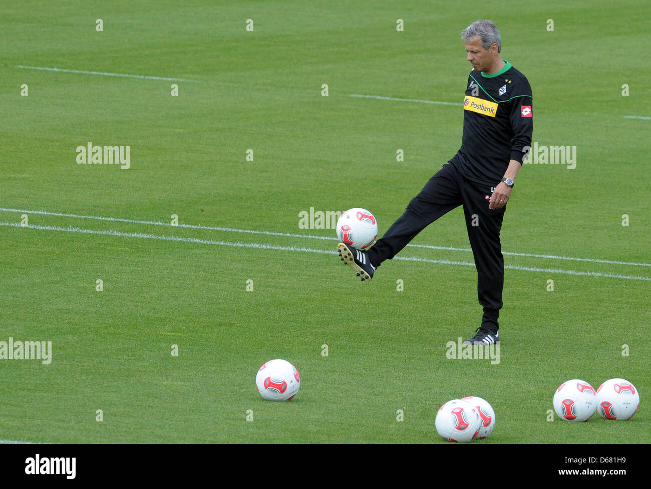 Moenchengladbach's head coach Lucien Favre plays the ball during the start of training after the summer break - Stock Image
