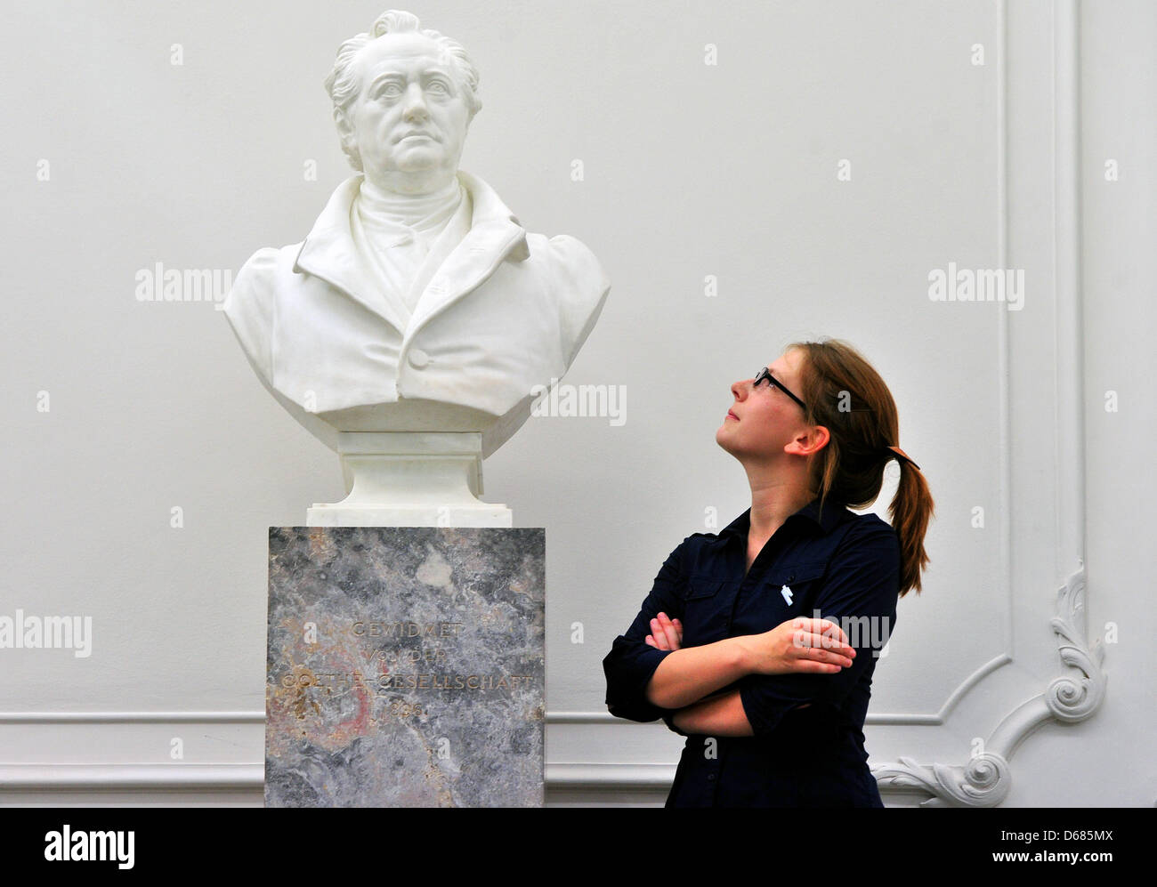 A young woman views a bust ofJohann Wolfgang Goethe at the Goethe and Schiller Archives in Weimar, Germany, 05 July - Stock Image