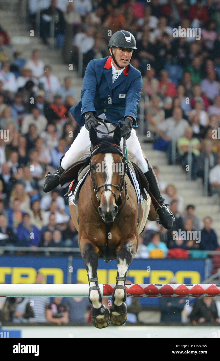 French show jumper Roger Yves Bost and horse Nippon jump over an obstacle during CHIO World Equestrian Festival - Stock Image