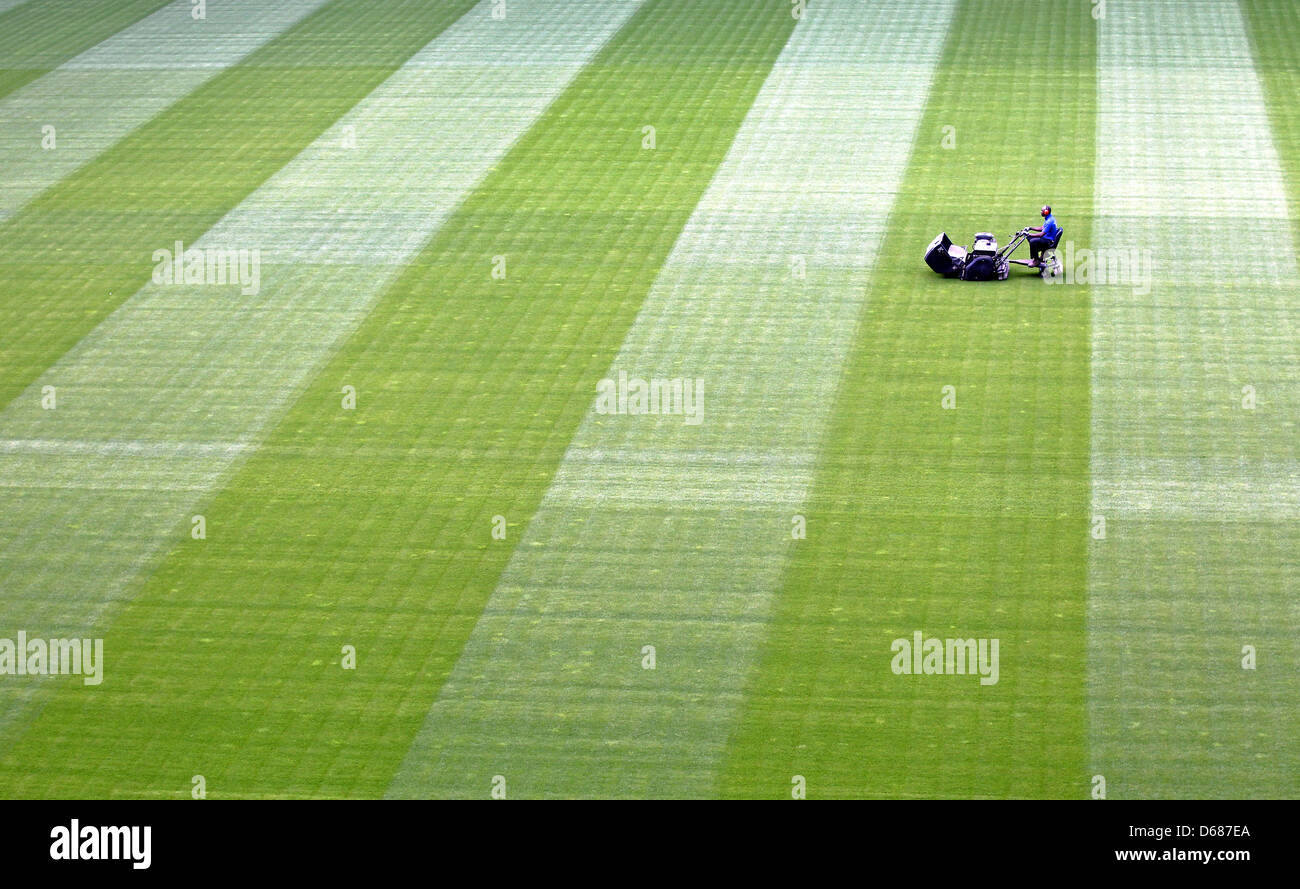 A greens keeper cares for the pitch at Red Bull Arena for the Regionalliga club RasenBallsport Leipzig in Leipzig, - Stock Image