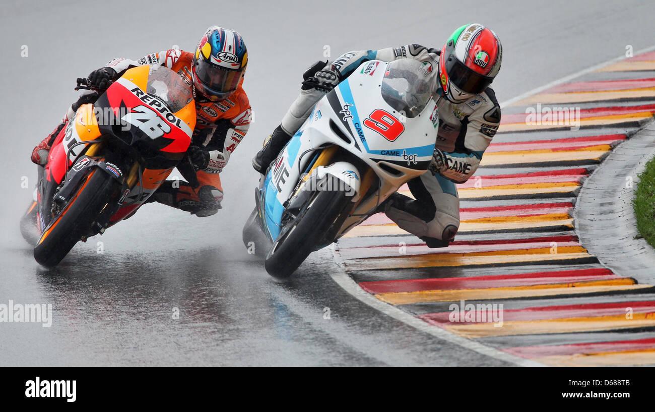 Spanish MotoGP driver Dani Pedrosa (L) of Honda Repsol Team drives next to Italian driver Danilo Petrucci of Team - Stock Image