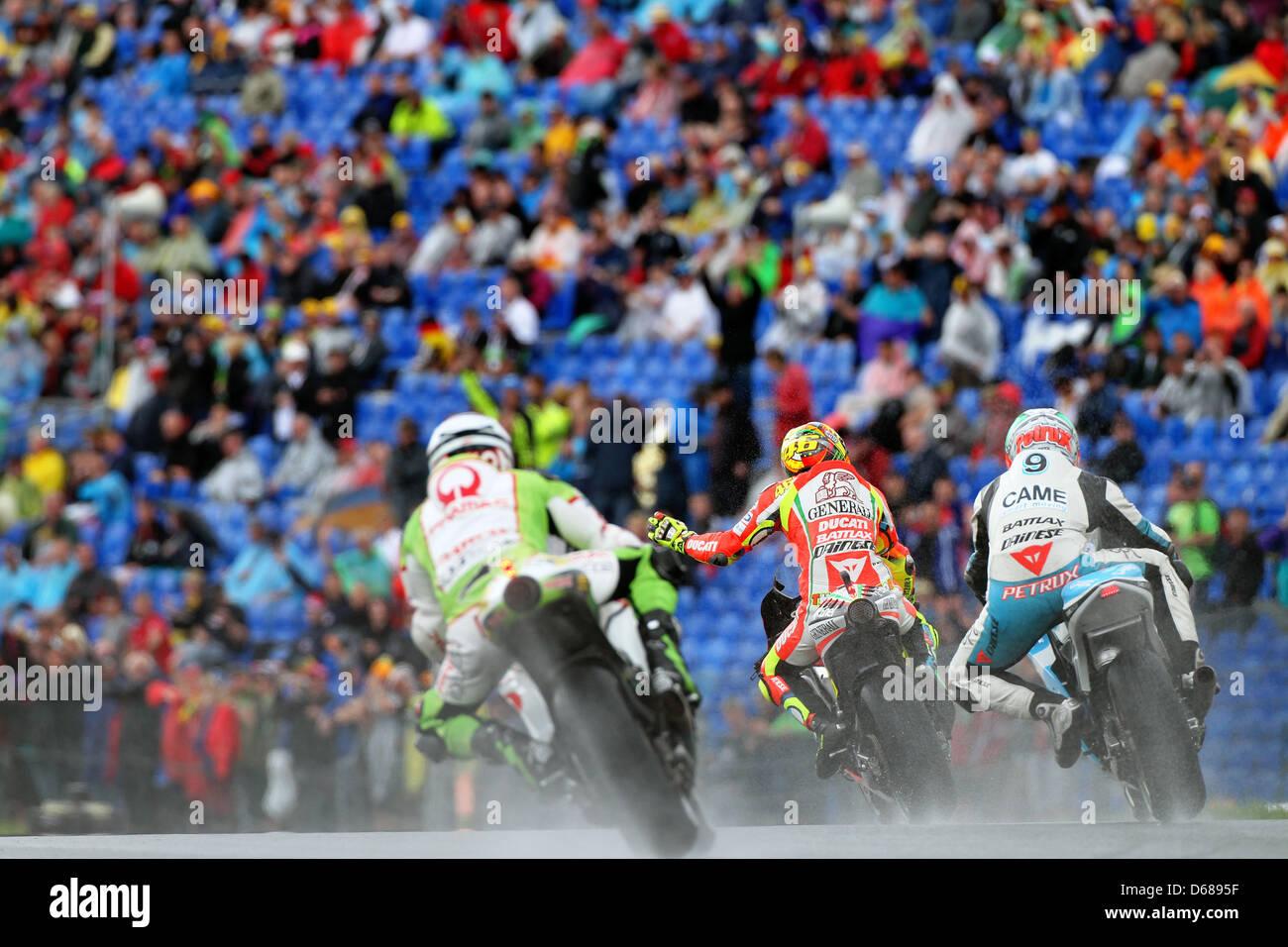 Italian MotoGP driver Valentino Rossi (M) of Team Ducati greets the fans between Italian driver Danilo Petrucci - Stock Image