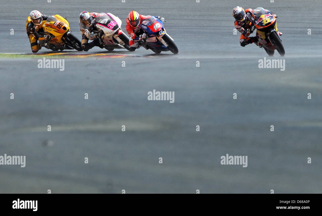 German rider Sandro Cortese of Team Red Bull KTM leads the Moto3 race ahead of French rider Alexis Masbou, Spanish - Stock Image