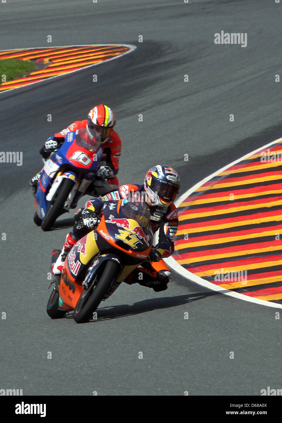 German rider Sandro Cortese of Team Red Bull KTM leads the Moto3 race ahead of French rider Alexis Masbou of Team - Stock Image