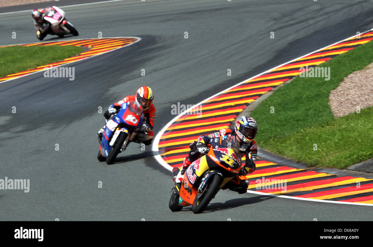 German rider Sandro Cortese of Team Red Bull KTM leads the Moto3 race ahead of French rider Alexis Masbou and Spanish - Stock Image