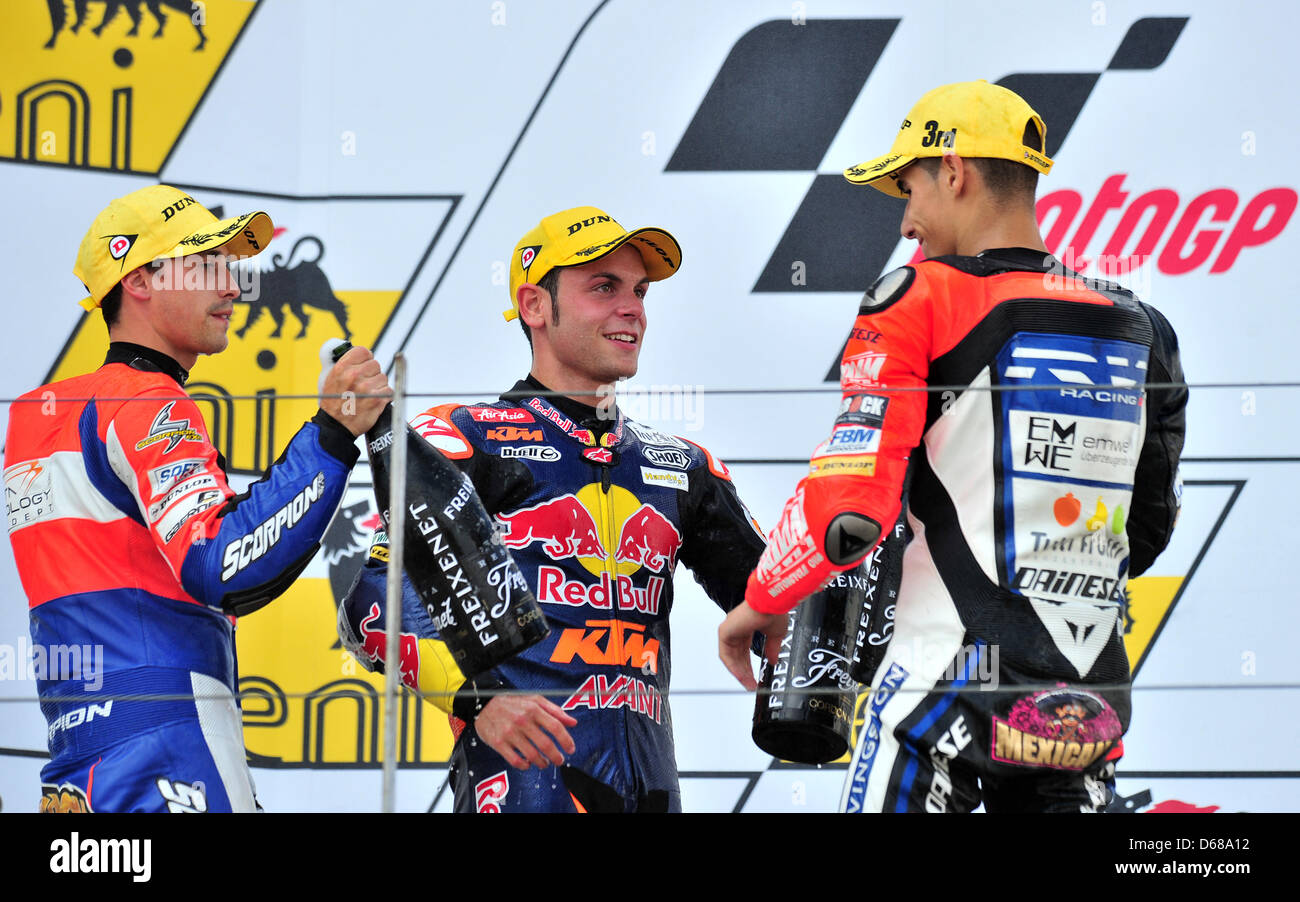 German rider Sandro Cortese of Team Red Bull KTM (C) wins the Moto3 race with French rider Alexis Masbou (L) and - Stock Image