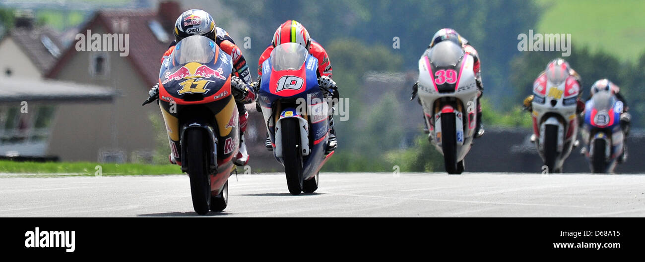 German rider Sandro Cortese of Team Red Bull KTM (C) leads the field in the the Moto3 race ahead of French rider - Stock Image