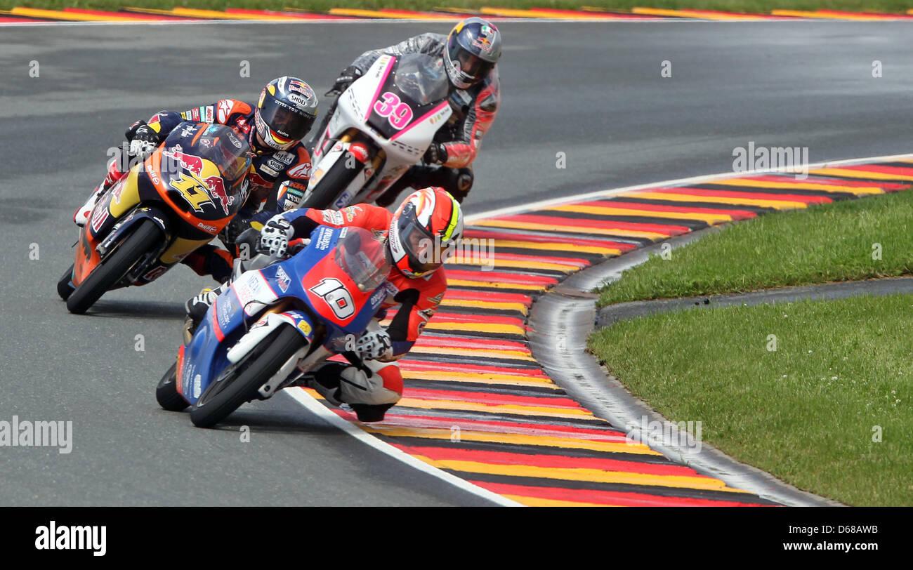 French MotoGP rider Alexis Masbou of Team Caretta Technology leads the field ahead of German rider Sandro Cortese Stock Photo