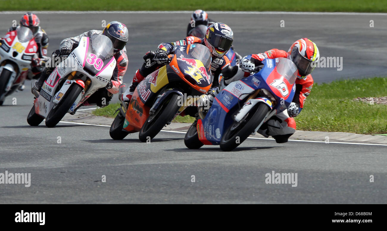 (L to R) French MotoGP rider Alexis Masbou of Team Caretta Technology leads the field ahead of German rider - Stock Image