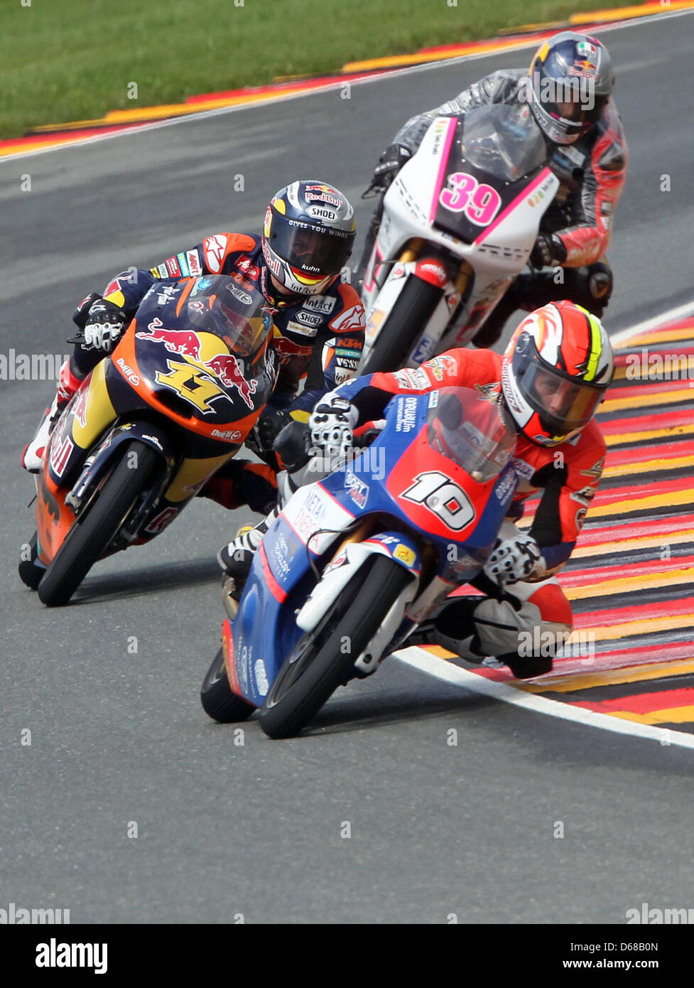 French MotoGP rider Alexis Masbou of Team Caretta Technology leads the field ahead of German rider Sandro Cortese - Stock Image